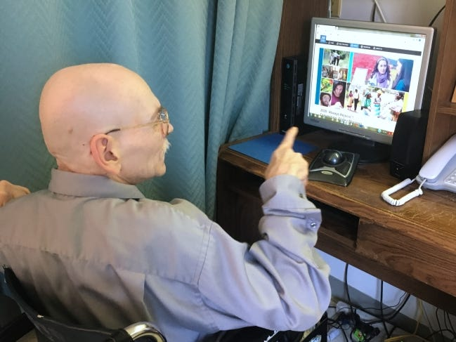 Steve Bruton connects with his Jehovah's Witnesses faith group via computer. [Photo provided]