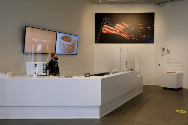 """An authorized replica of Ed Ruscha's 2017 painting """"Our Flag"""" is displayed in the lobby of the Oklahoma Contemporary Arts Center on Automobile Alley, Friday, February 12, 2021. The new exhibit """"Ed Ruscha: OKLA exhibit"""" is on view through July 5 at Oklahoma Contemporary. [Doug Hoke/The Oklahoman]"""