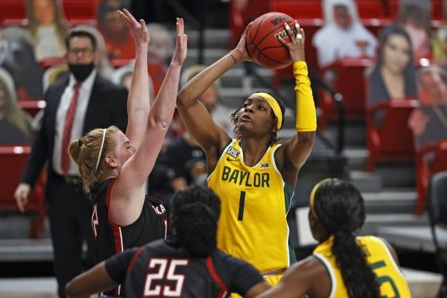 Baylor's NaLyssa Smith (1) shoots the ball over Texas Tech's Vivian Gray (12) during a game on Feb. 10 in Lubbock, Texas. [AP Photo/Brad Tollefson]