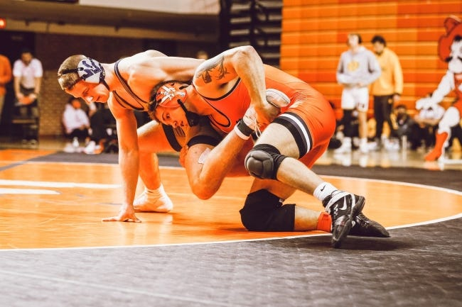 Oklahoma State's Travis Wittlake, right, is ranked No. 3 nationally at 165 pounds with an 11-0 record. [OSU Athletics]