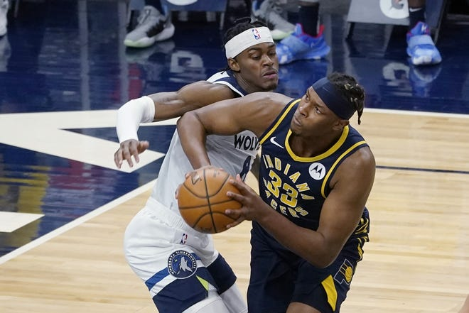 Indiana Pacers' Myles Turner (33) eyes the basket as he works around Minnesota's Jaylen Nowell (4) during a game in Minneapolis Wednesday. Turner has turned a response to a fan into a fundraiser for Texans struggling due to weather conditions. [AP Photo/Jim Mone]