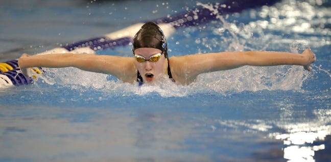 Newcastle's Ashley Leader competes in the 100-yard butterfly during the Class 5A state meet in Edmond on Feb. 16, 2019. [Sarah Phipps/The Oklahoman]