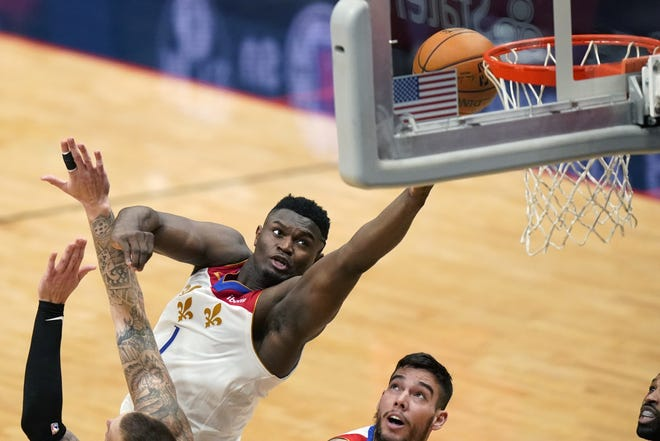 New Orleans Pellicans forward Zion Williamson (1) goes to the basket in a game against Boston on Sunday. [AP Photo/Gerald Herbert]