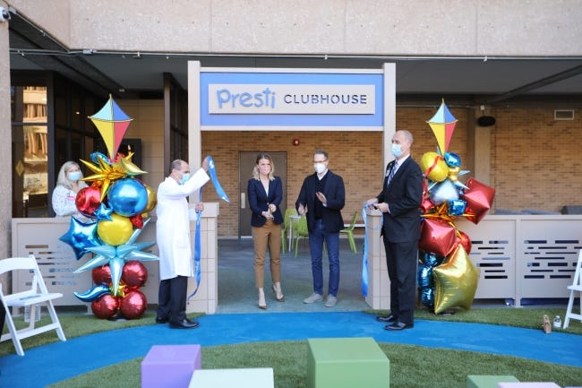 Sam Presti and his wife, Shannon, take part in the ribbon cutting ceremony for the Presti Clubhouse on Monday at Oklahoma Children's Hospital. [Photo provided by Oklahoma Children's Hospital]