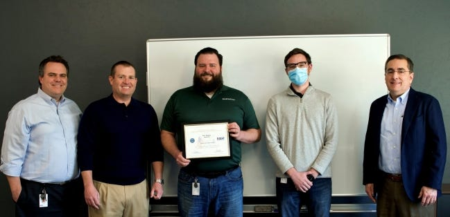 BankOnIT employees pictured, from left, are Sean Corbin, senior vice president; Ryan Samples, CEO; Eric Magley, vice president; Alex Weeks, inventory supervisor and National Guard member; and Robert Mendez, executive vice president. [PHOTO PROVIDED]