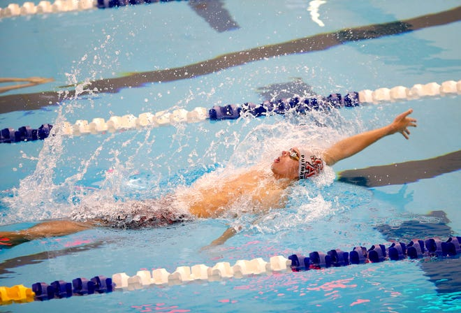 Carl Albert's Kaleb Putnam competes in the 100-yard backstroke during the Class 5A state meet Tuesday in Edmond. [Sarah Phipps/The Oklahoman]