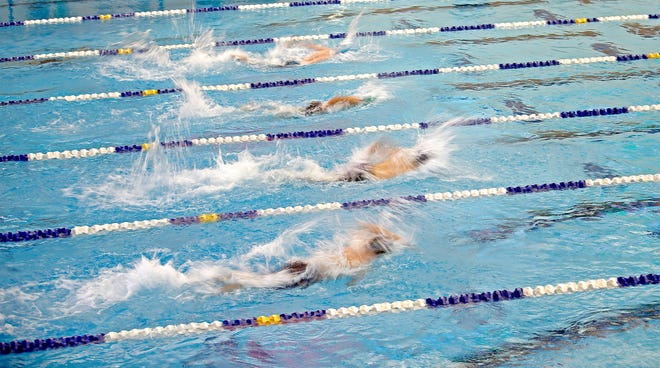 Swimmers compete during the Class 5A boys swimming state meet in Edmond on Tuesday. [Sarah Phipps/The Oklahoman]