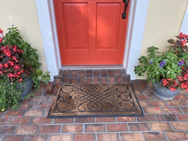 Your front door is your handshake to the world. If your tattered doormat isn't welcoming, like the one pictured above, spring for a new one. [PROVIDED/MARNI JAMESON]