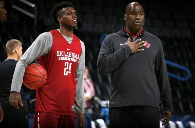 Former OU star Buddy Hield, left, talks with assistant Chris Crutchfield in 2016. Crutchfield is in his first year as the head coach at East Central University in Ada, a move he made to coach his two sons but also get head coaching experience. [Bryan Terry/The Oklahoman]