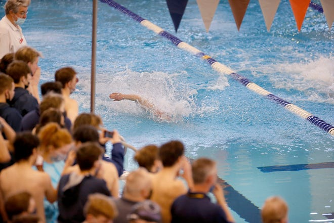 Teams cheer on swimmers during the Class 5A boys state meet in Edmond on Tuesday. [Sarah Phipps/The Oklahoman]