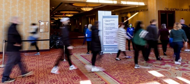 People file in for the Covid-19 vaccination pod at the Embassy Suites by Hilton Norman Hotel & Conference Center on Monday. [Chris Landsberger/The Oklahoman]