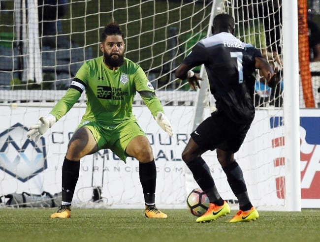 Oklahoma City goalkeeper Cody Laurendi (1) defends a shot attempt by San Antonio's Billy Forbes (7) during a soccer game in 2017. [THE OKLAHOMAN ARCHIVES]
