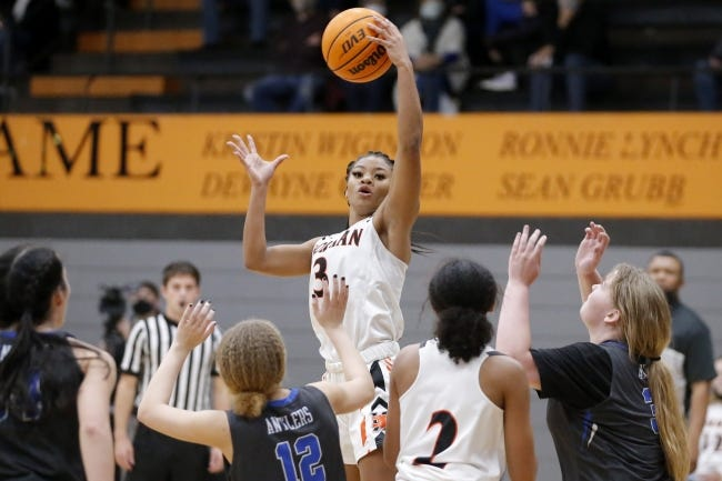 Norman's Aaliyah Henderson grabs a rebound during a high school girls basketball game against Deer Creek on Jan. 5. [Bryan Terry/The Oklahoman]