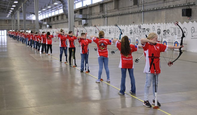 The Locust Grove archery team shoots from the 10-yard line at the state archery championships in the Pavilion building at the OKC Fairgrounds on Wednesday. [Doug Hoke/The Oklahoman]