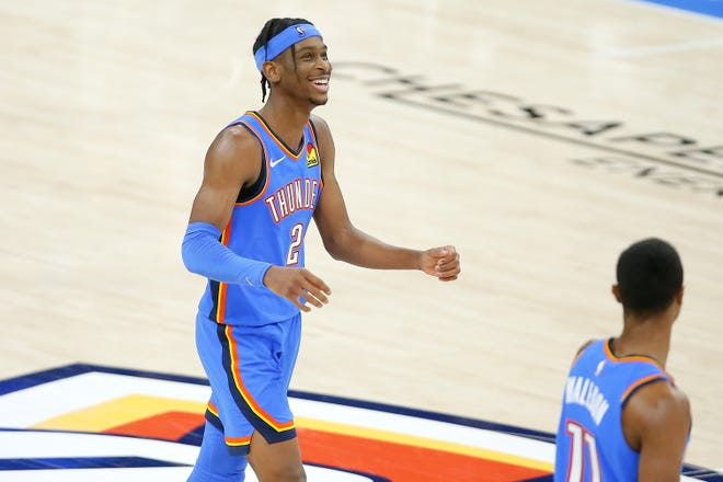 Thunder guard Shai Gilgeous-Alexander (2) smiles after an assist against the Heat on Monday at Chesapeake Energy Arena. [Bryan Terry/The Oklahoman]