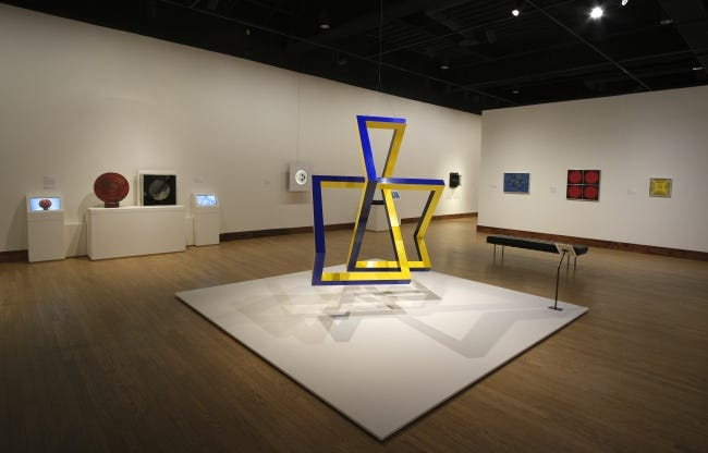 """Forrest Myers' suspended sculpture """"Lazers Daze (Zane's Match)"""" is featured in the Oklahoma City Museum of Art's new exhibit """"Moving Vision: Op and Kinetic Art from the Sixties and Seventies."""" The exhibit is on view through May 16. [Doug Hoke/The Oklahoman]"""
