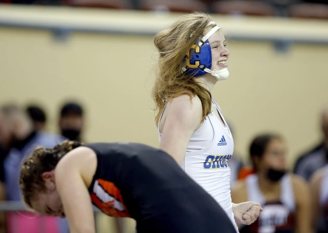 Choctaw's Peyton Hand celebrates her win over Pawhuska's Landon McCartney in the 112 pound weight class during the girl's state wrestling championships inside Jim Norick Arena at the OKC Fairgrounds in Oklahoma City, Thursday, Feb. 25, 2021. [Sarah Phipps/The Oklahoman]