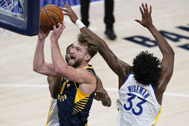 Indiana Pacers' Domantas Sabonis (11) shoots next to Golden State Warriors' James Wiseman (33) during the first half of a game in Indianapolis, Wednesday. Sabonis is set to replace Kevin Durant in the NAB All-Star game. [AP Photo/Darron Cummings]