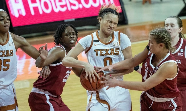 Texas' Celeste Taylor gets tied up with Oklahoma's Gabby Gregory for a jump ball Saturday in the Sooners' 68-63 win at the Erwin Center in Austin, Texas. [RODOLFO GONZALEZ/FOR THE AMERICAN-STATESMAN]
