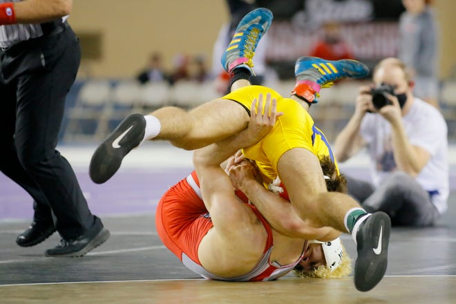 Stillwater's Anthony Ferrari pins Mustang's John Wiley in the Class 6A 160-pound match in the Class 3A and 6A high school state wrestling championships in Jim Norick Arena at the OKC Fairgrounds in Oklahoma City, Saturday, Feb. 27, 2021. [Bryan Terry/The Oklahoman]