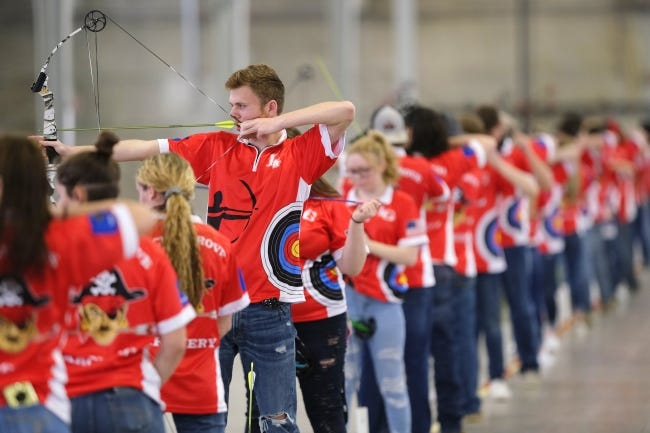 Junior Joshua Willis of Locust Grove shoots with the rest of the Pirates' archery team at the state archery championships Wednesday in the Pavilion building at the OKC Fairgrounds. Locust Grove was the high school state team champion. [Doug Hoke/The Oklahoman]