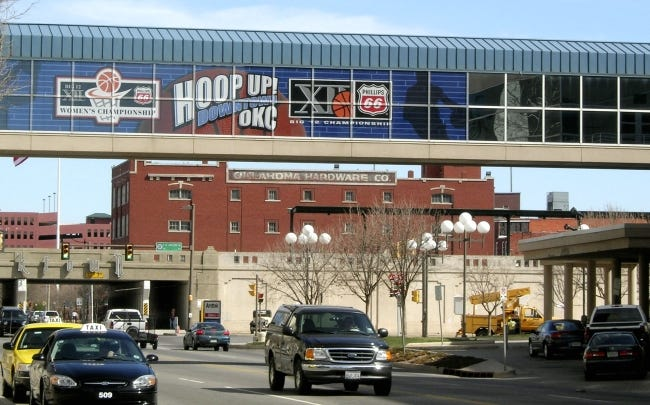 A Hoop Up OKC 2007 Big XII banner is shown on the skywalk between the former Cox Convention Center and the former Renaissance Hotel. The skywalk has been used to promote numerous sports and cultural events since going up 20 years ago. [THE OKLAHOMAN ARCHIVES]