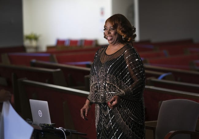 """Jeanise Jones, one of the breakout stars of """"Borat Subsequent Moviefilm,"""" stands in the sanctuary of Ebenezer Baptist Church in Oklahoma City to tape a segment for Sunday's Golden Globes award ceremony. [Doug Hoke/The Oklahoman]"""