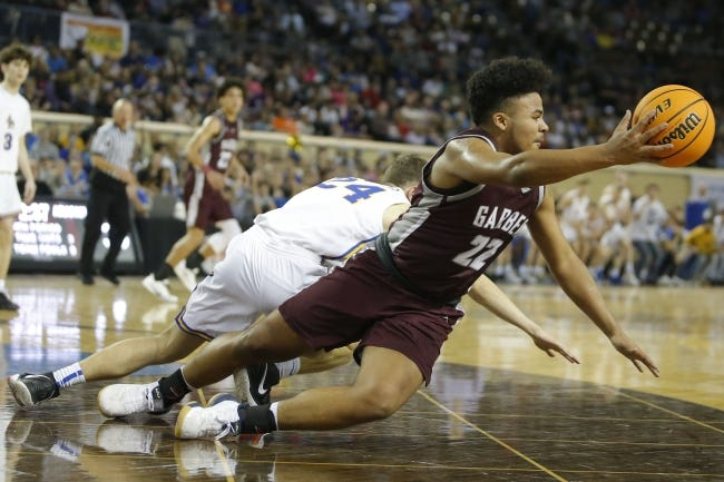 Garber's Ty Chester (22) tips the ball in front of Arapaho-Butler's Brock Walker (24) during the Class A boys state basketball tournament championship game last March at State Fair Arena. [Bryan Terry/The Oklahoman]