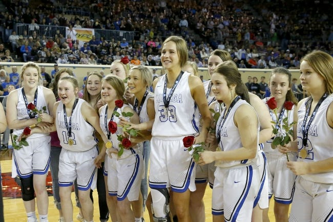 Lomega gets ready to get their trophy after winning the Class B girls state basketball championship last March against Varnum. [Bryan Terry/The Oklahoman]