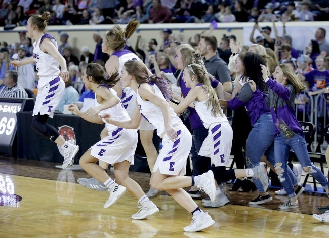 Hydro-Eakly players rush the court after winning the Class A girls basketball state title over Canute at State Fair Arena on March 7, 2020. [Sarah Phipps/The Oklahoman]