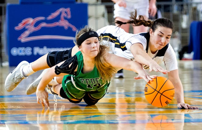 Kiowa's Kye Stone (44) goes after a loose ball agains Leedey's Rylie Gore (14) during the Class B Girls basketball game between Kiowa and Leedey at the State Fair Arena in Oklahoma City, Okla. on Tuesday, March 2, 2021. [Chris Landsberger/The Oklahoman]