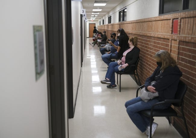 People wait in line at the OKC Indian Clinic to receive a Moderna vaccine. Indian Health Service hitting the 500,000 dose mark in COVID-19 vaccine distribution. Tuesday, March 2, 2021. [Doug Hoke/The Oklahoman]