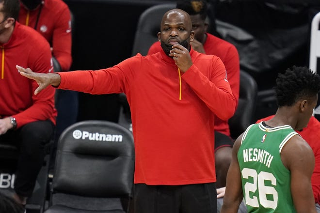 Atlanta Hawks associate head coach Nate McMillan calls to his players during a game against the Celtics in Boston, on Feb. 17. McMillan was named the NBA team's interim head coach on Tuesday. [AP Photo/Charles Krupa]
