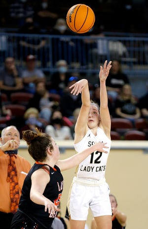 Seiling's Braci Nyberg shoots as Cheyenne's Abbi Ford during a Class A girls high school basketball state tournament game between Seiling and Cheyenne at the State Fair Arena in Oklahoma City , Wednesday, March 3, 2021. [Sarah Phipps/The Oklahoman]