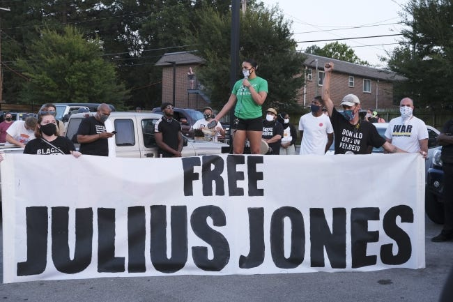 Francie Ekwerekwu speaks about Julius Jones during a march in August.[Doug Hoke/The Oklahoman]