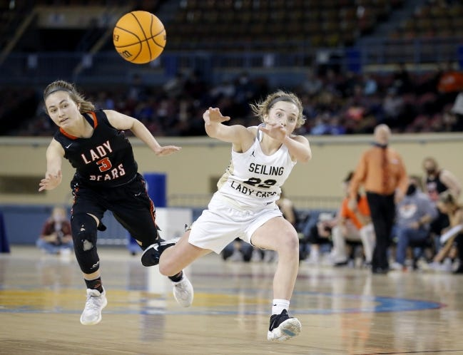 Seiling's Kenly Gore passes the ball as Cheyenne's Chloe McEntrie defends during a 55-36 win Wednesday in the Class A girls basketball state tournament at State Fair Arena. [Sarah Phipps/The Oklahoman]