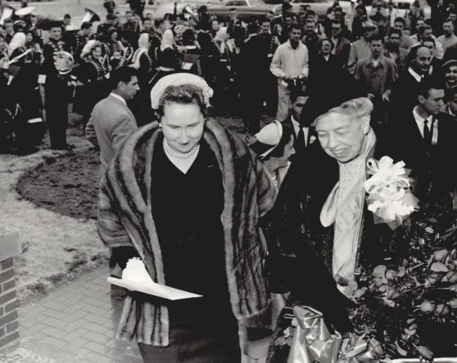 Norman Mayor June Benson, at left, walks with Eleanor Roosevelt during the former first lady's visit to Norman. Roosevelt, along with former President Harry S. Truman, was to speak at the University of Oklahoma Young Democrats' 25th anniversary celebration of Franklin D. Roosevelt's inauguration. Eleanor Roosevelt, who also served as a delegate to the United Nations, was made an honorary citizen of Norman upon her arrival. This photo was taken on March 4, 1958, and was published in The Daily Oklahoman. Benson was the first woman selected as mayor of Norman, serving as mayor from 1957 to 1960. [JIM LUCAS/THE OKLAHOMAN ARCHIVES]