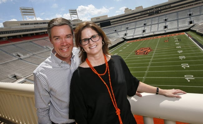 Chad Weiberg and his wife, Jodi, pictured in 2017 inside Boone Pickens Stadium. Chad will become OSU's new athletic director in July, the university announced Thursday. [The Oklahoman Archives]