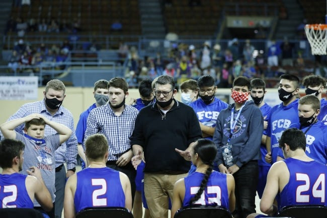 Fort Cobb-Broxton head coach Scott Hines talks to his team during a timeout against Garber during a Class A game at State Fair Arena on Thursday. [Alonzo Adams/for The Oklahoman]