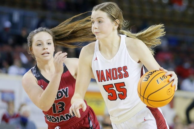 Vanoss' Emrie Ellis drives past Vici's Dru McGehee during a 69-48 win Friday in a Class A semifinal at State Fair Arena. [Bryan Terry/The Oklahoman]