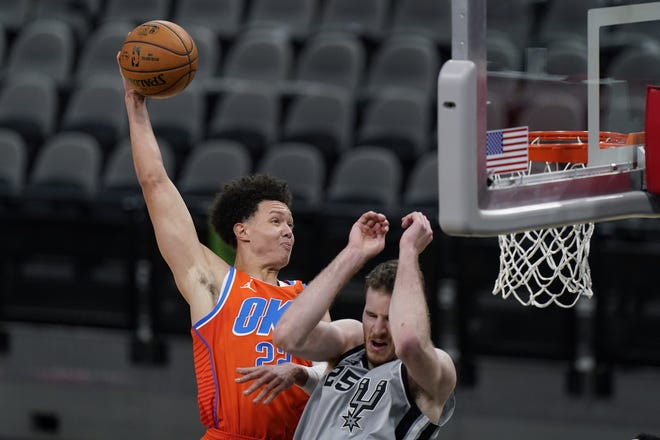 Thunder center Isaiah Roby (22) dunks over Spurs center Jakob Poeltl (25) during the second half of Oklahoma City's 107-102 win Thursday night in San Antonio. [AP Photo/Eric Gay]