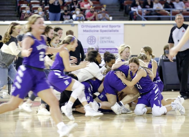 Hydro-Eakly celebrates after beating Vanoss 69-48 to win the Class A girls basketball state championship Saturday at State Fair Arena in Oklahoma City. [Sarah Phipps/The Oklahoman]