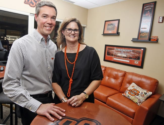 Chad Weiberg and his wife, Jodi Weiberg, pose for a photo in 2017 inside the Boone Pickens Stadium suite where they got engaged years early. [OKLAHOMAN ARCHIVES]
