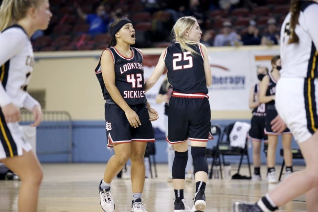 Lookeba-Sickles' Keeli Cox (42) and Madi Barger (25) react after Cox's game tying 3-point basket was ruled a 2-point basket on Thursday in a Class B girls high school basketball state tournament game. [Sarah Phipps/The Oklahoman]