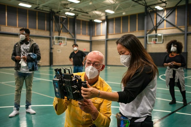"""OKC screenwriter, producer and director Lance McDaniel, left, and producer Hui Cha Poos work behind the scenes of their holiday movie """"FInding Carlos."""" [Zachary Burns/McDaniel Entertainment]"""