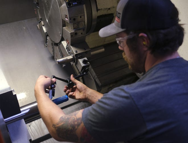 A machine shop employee at Critical Components in Oklahoma City checks thread tolerance. Some manufacturing companies like Critical Components have begun a pivot from making products for the oil and gas industry toward aerospace manufacturing. [DOUG HOKE/THE OKLAHOMAN]