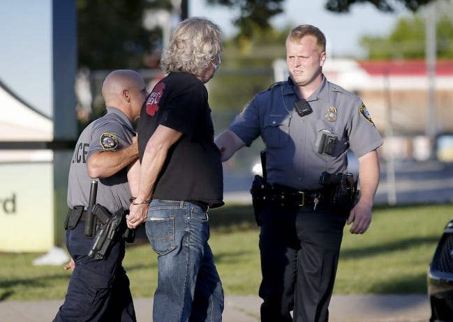 In this May 30 photo, police officers arrest a protester in the intersection of NW 23 and Classen. The protest was in response to the death of George Floyd. [Sarah Phipps/The Oklahoman]