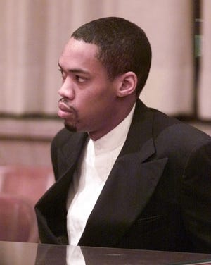 At his 2002 sentencing, Julius Jones listens as jurors select the death penalty as his punishment. [Oklahoman archive photo]