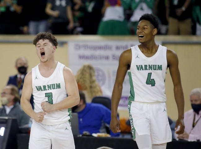 Varnum's Martell Davis, right, and Kaden Jasna celebrate during the Class B boys basketball state championship game against Roff on Saturday. [Sarah Phipps/The Oklahoman]