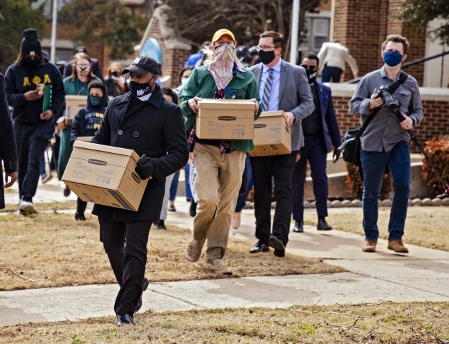 In this Feb. 25 photo, supporters of death row inmate Julius Jones march to Oklahoma Pardon and Parole Board to deliver a petition with more than six million signatures calling for his release. [Chris Landsberger/The Oklahoman]